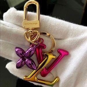 Louis Vuitton New wave bag charm key holder.